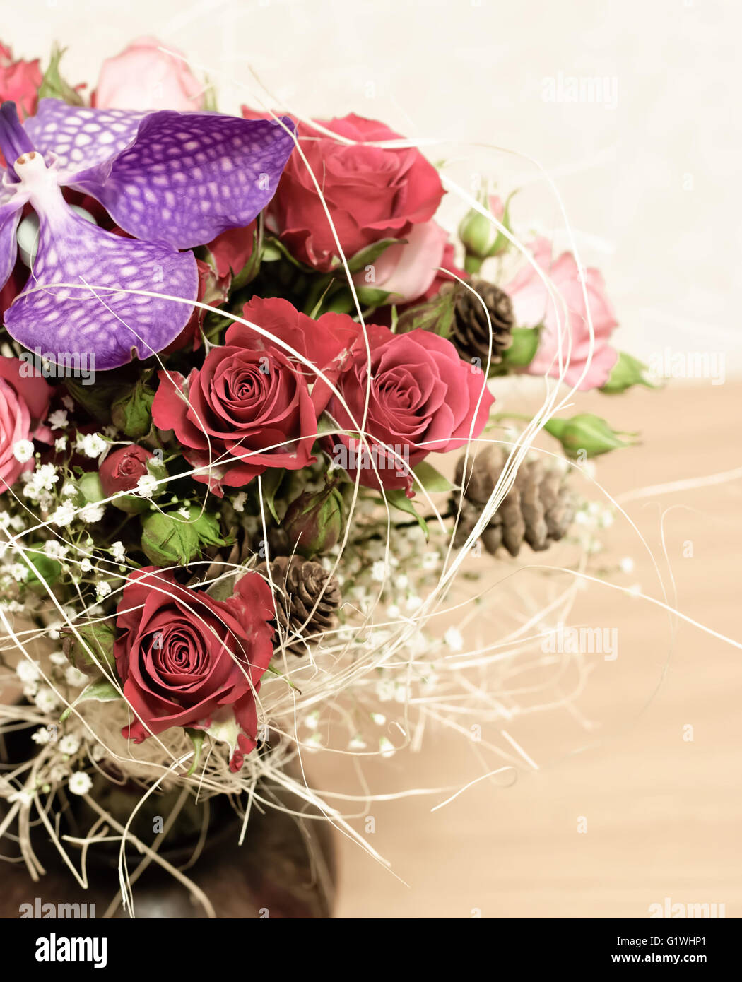 Floristic composition. Floral arrangement of red roses and orchid Vanda Stock Photo
