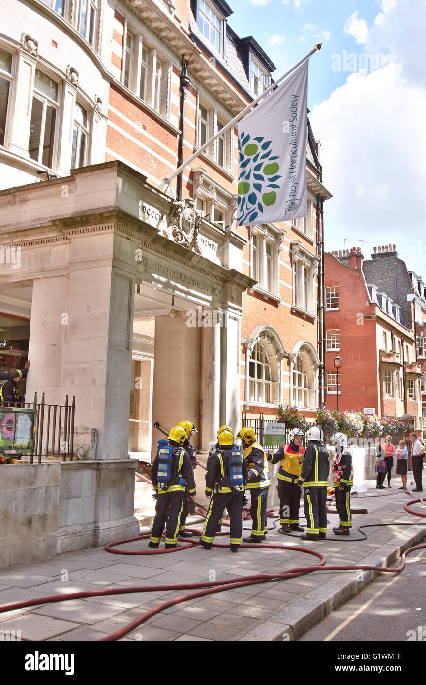 Fire fighters deal with a fire in the Royal Horticultural Halls, headquarters of the Royal Horticultural Society - Stock Image