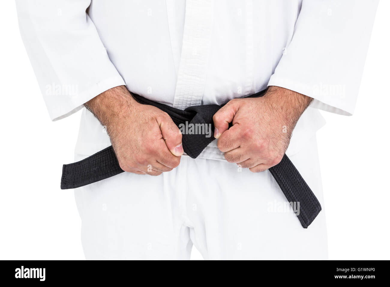 Close-up of karate fighter making fists - Stock Image
