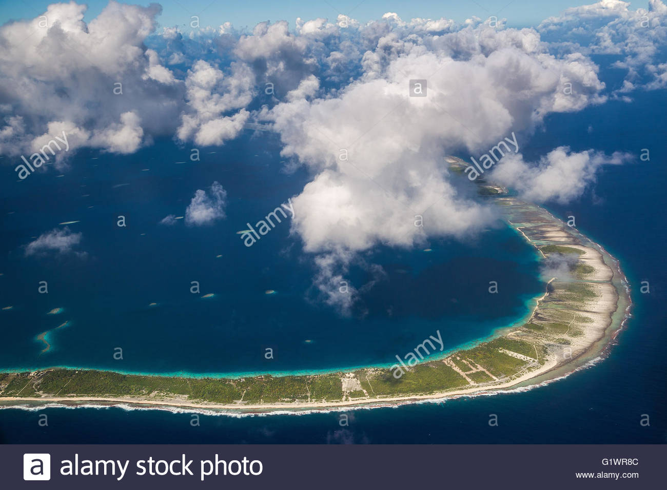 Flying over the Tuamotu islands (French Polynesia) - Stock Image