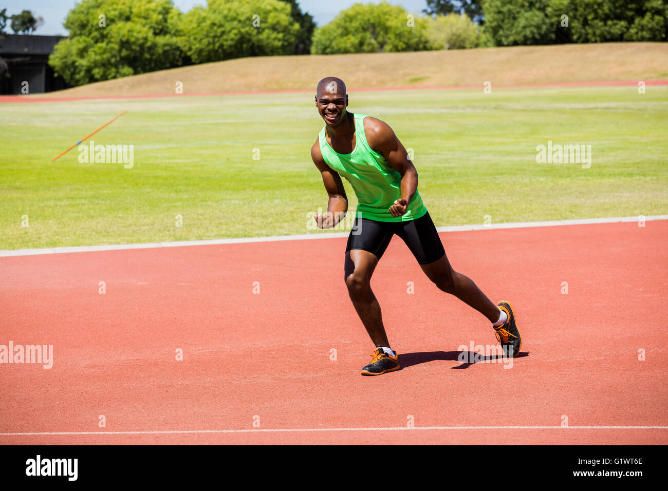 Portrait of a happy athlete posing - Stock Image