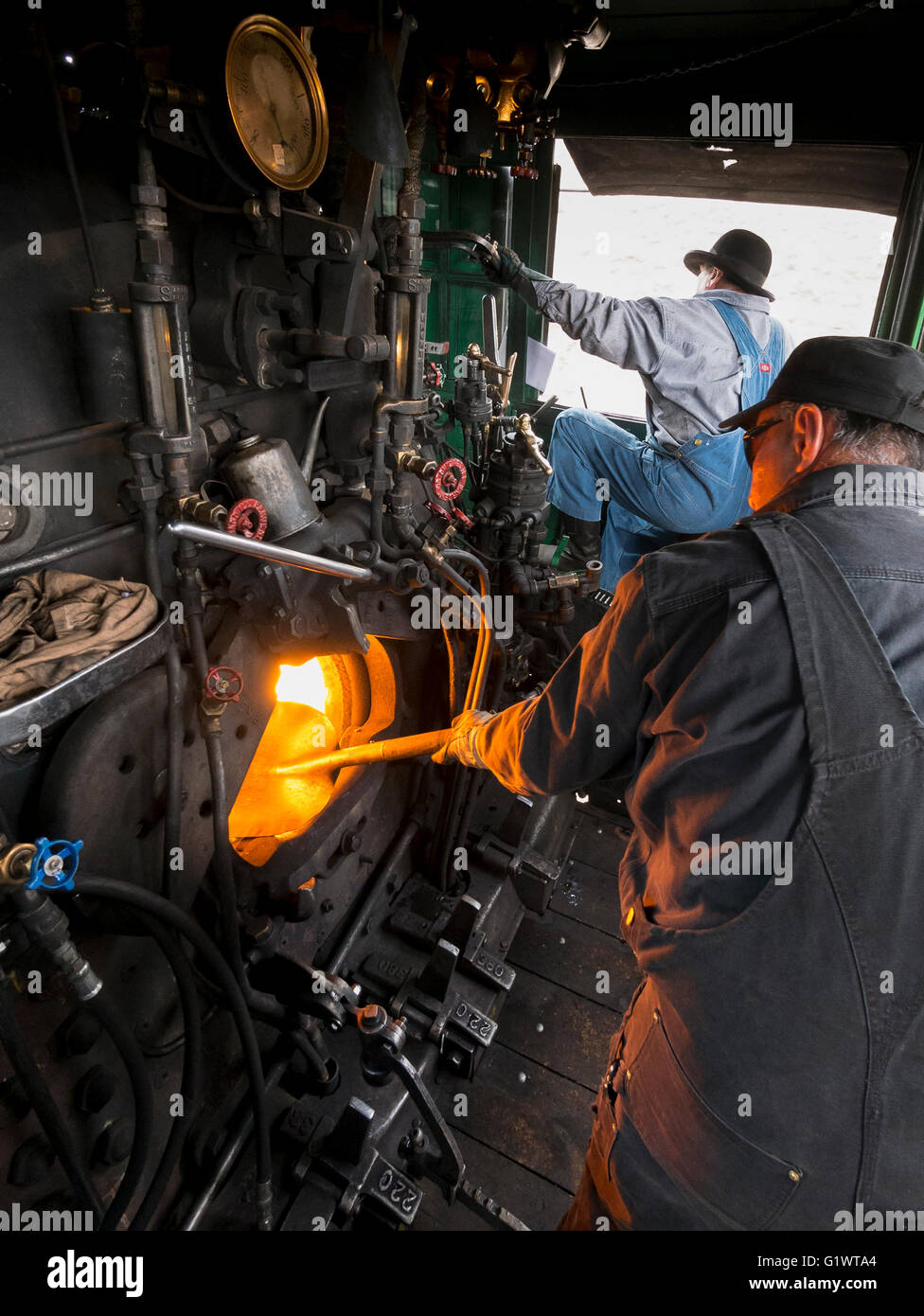 Fireman feeds the fire of locomotive 487, Cumbres & Toltec Scenic Railroad be - Stock Image