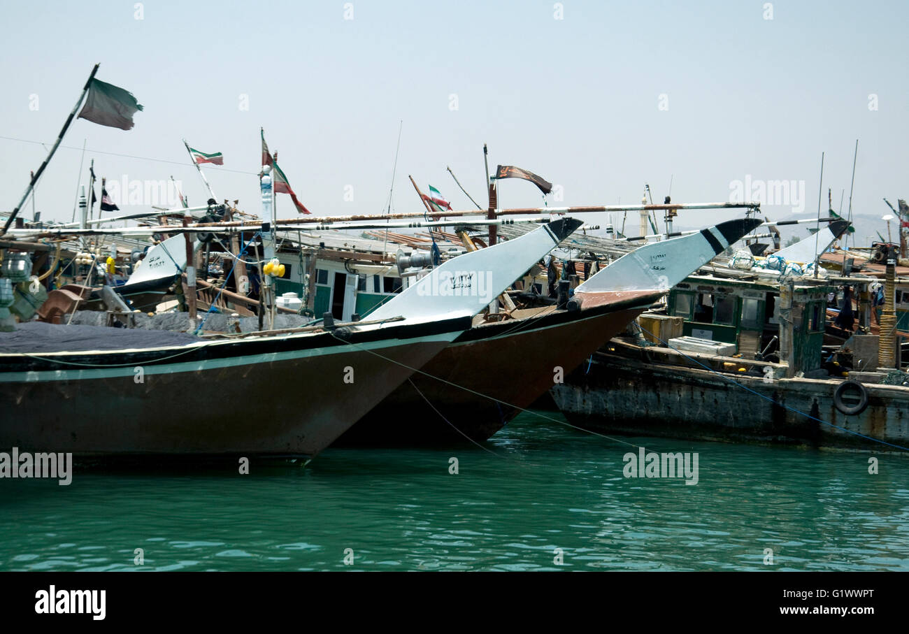 Fishing boats cluster tightly in Kong harbour, south coast, Iran - Stock Image