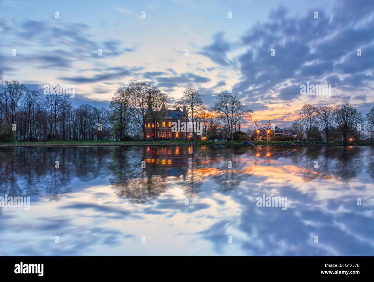 Cloudscape photo from a beautiful villa in Nigtevecht along the river Vecht in The Netherlands Stock Photo