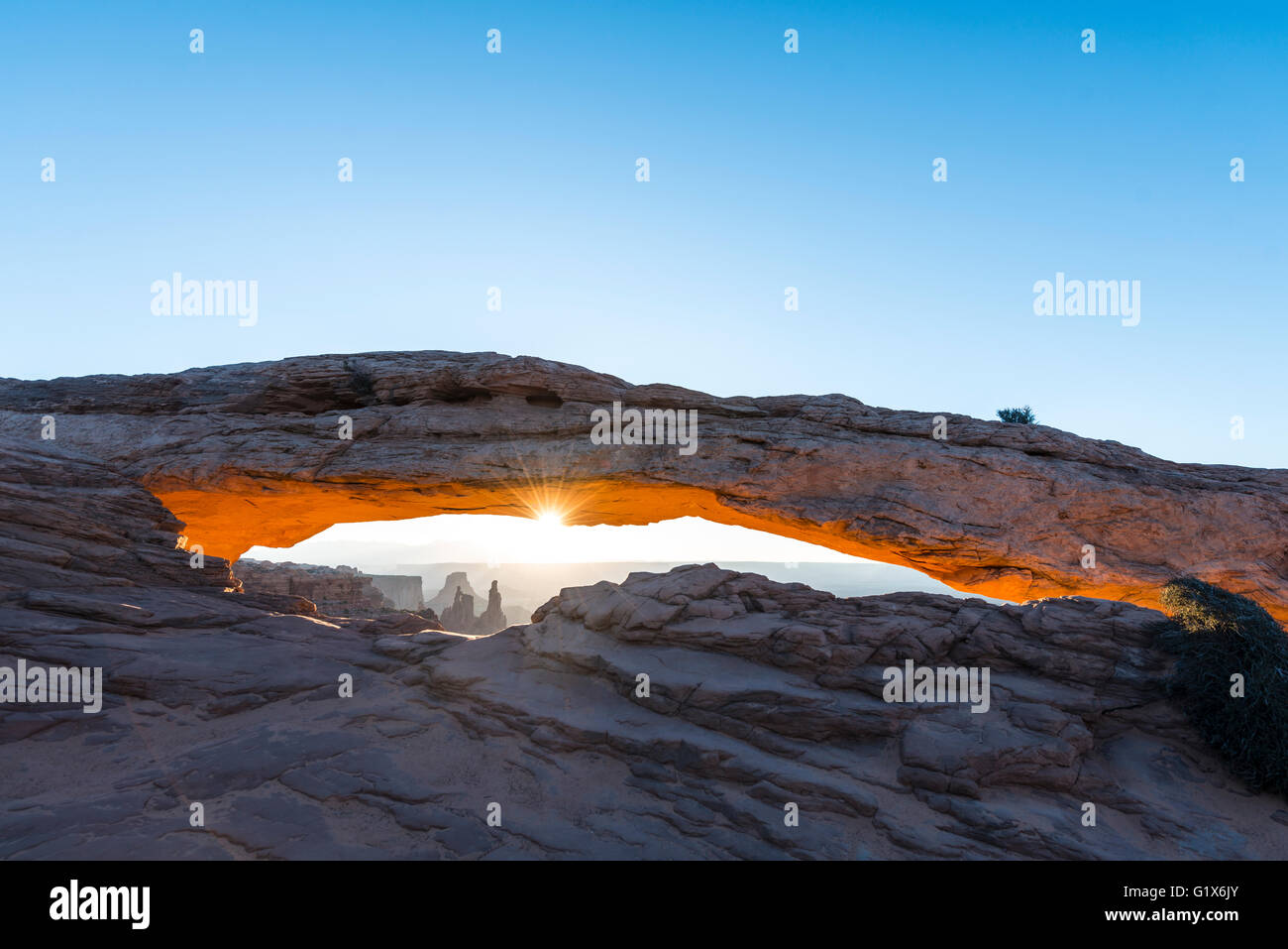 View through Natural Arch, Mesa Arch, Sunrise, Grand View Point Road, Island in the Sky, Canyonlands National Park, - Stock Image