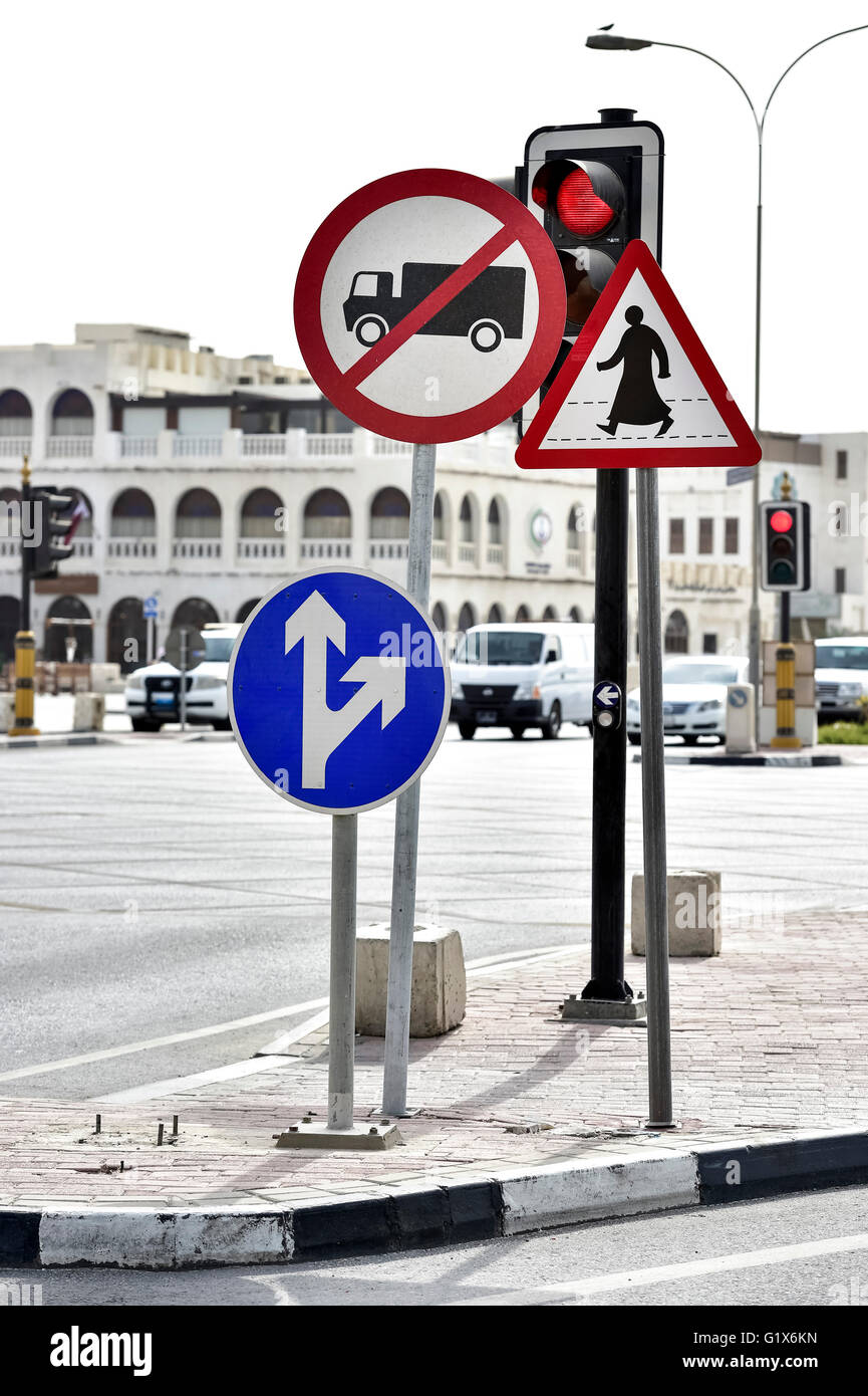 Street signals truck ban, respect pedestrians and red lights in Doha, Qatar - Stock Image