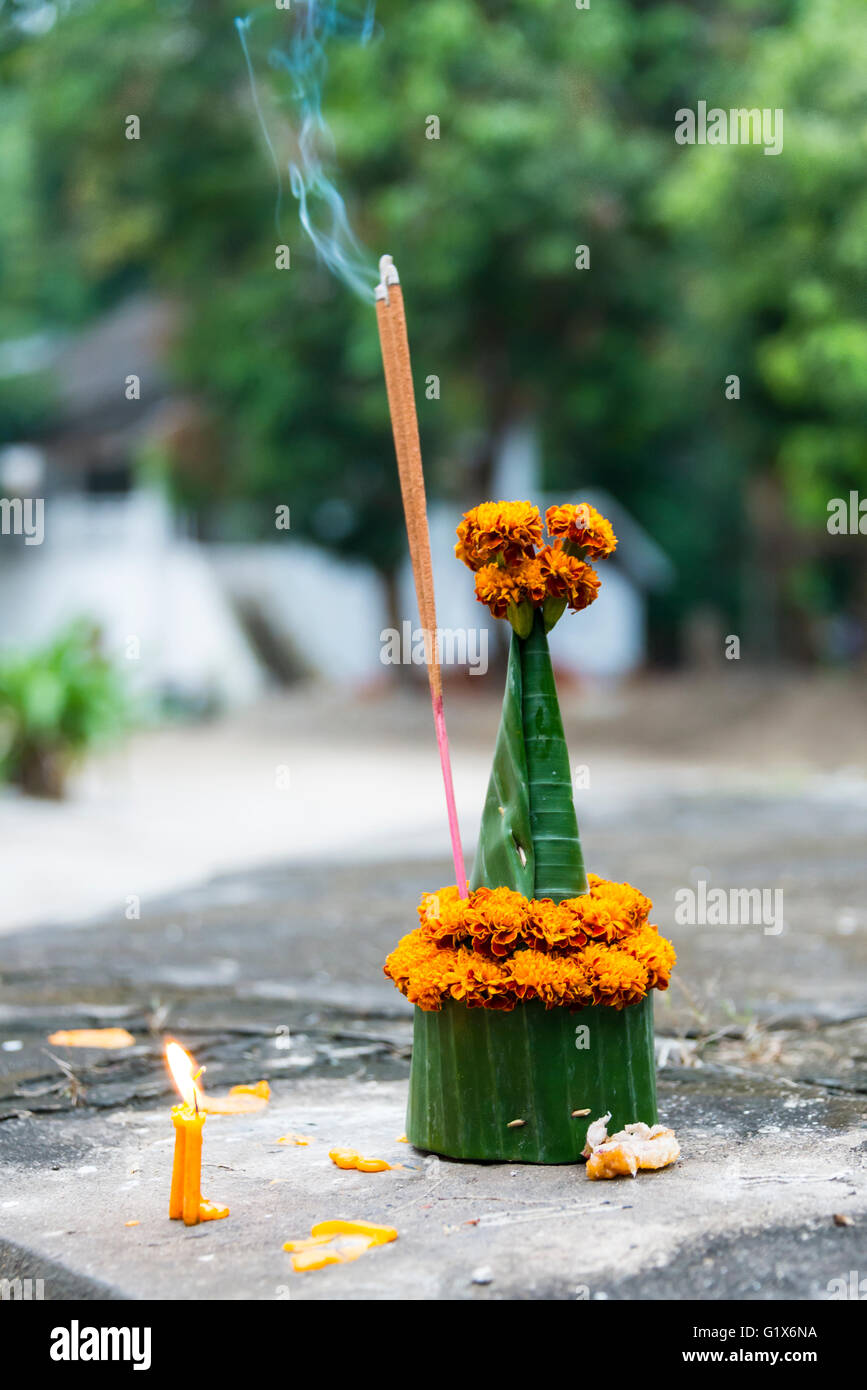 Floral offering, floral arrangement with incense, Wat Wisunalat, Luang Prabang Province, Louangphabang Province, Stock Photo