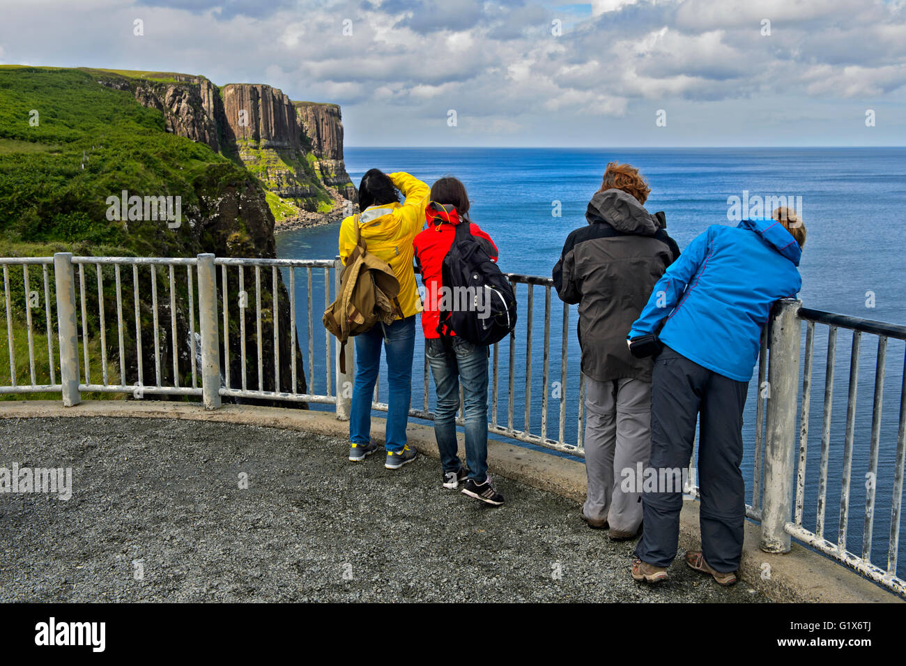 Tourists on the view point of the Kilt Rock Basaltic cliffs at Staffin, Isle of Skye, Scotland, United Kingdom - Stock Image