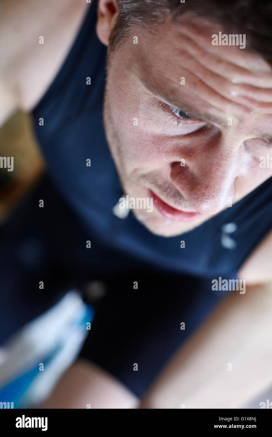 Portrait of a Man on a Bicycle Training for a Triathlon - Stock Image