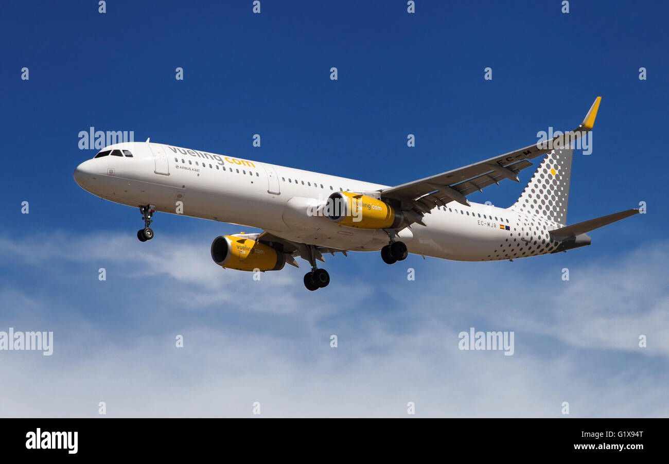A Vueling Airbus A321 approaching to El Prat Airport in Barcelona, Spain. - Stock Image