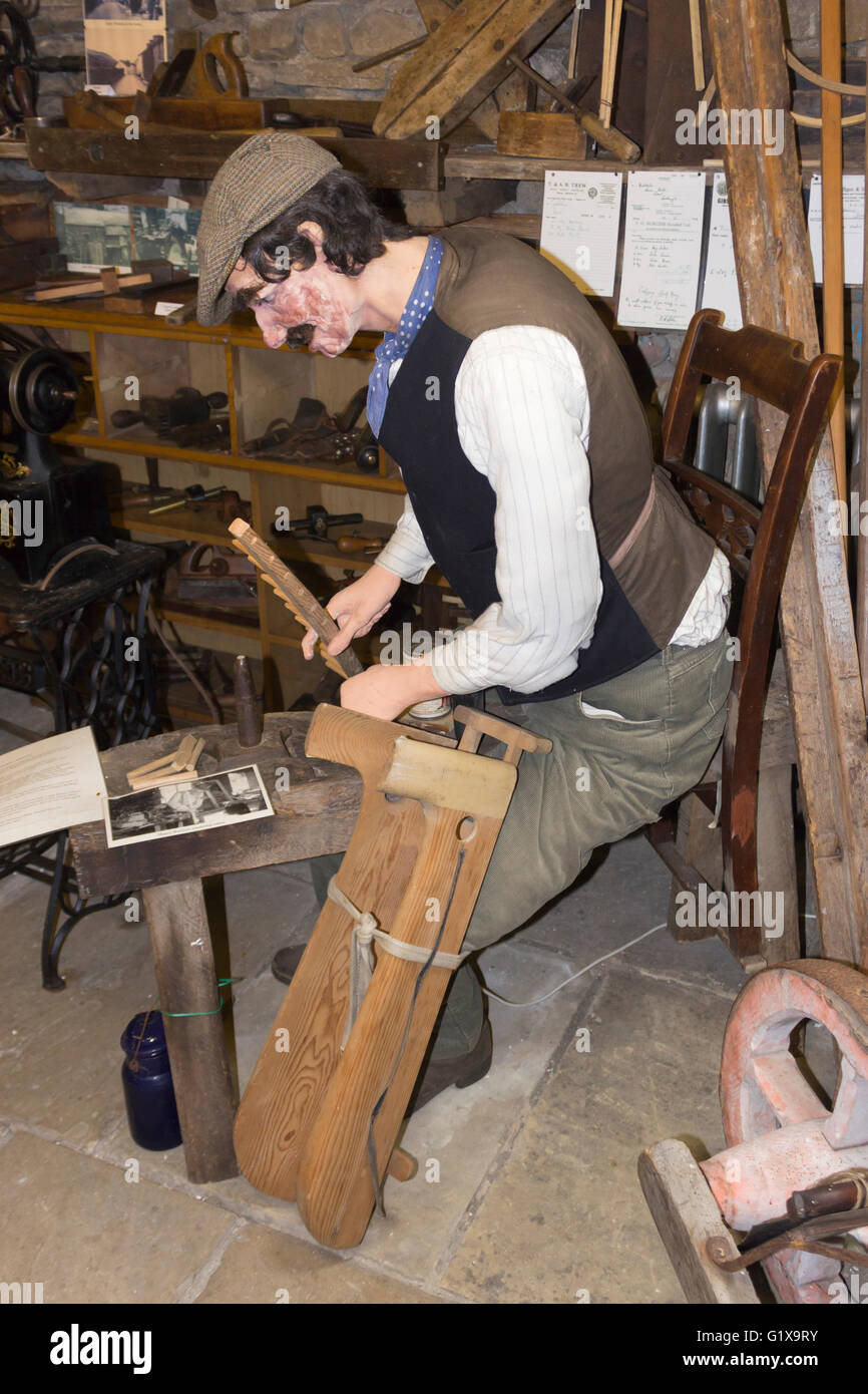 Dent Village Museum and Heritage Centre, Dent, Yorkshire Dales, England. A life size model of a man making a hay - Stock Image