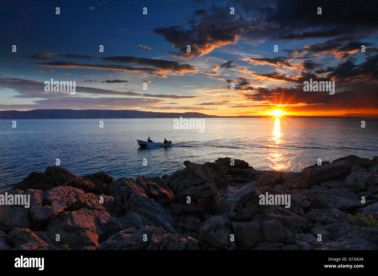 Dramatic sunset landscape at sea. - Stock Image