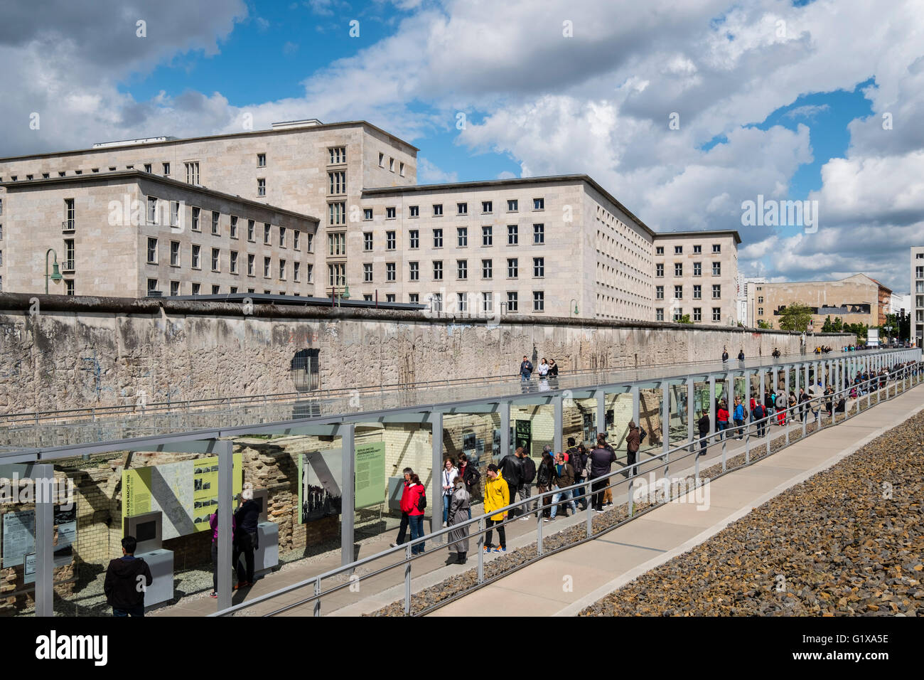 View of tourists visiting outdoor museum at Topography of Terror former Gestapo headquarters in Berlin Germany - Stock Image