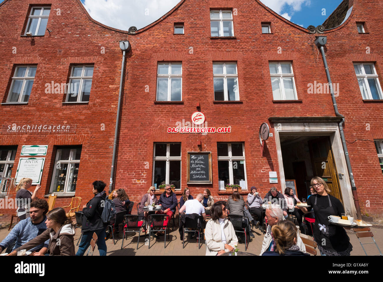 Cafe in front of traditional Dutch style house in Dutch Quarter in Potsdam Brandenburg Germany - Stock Image