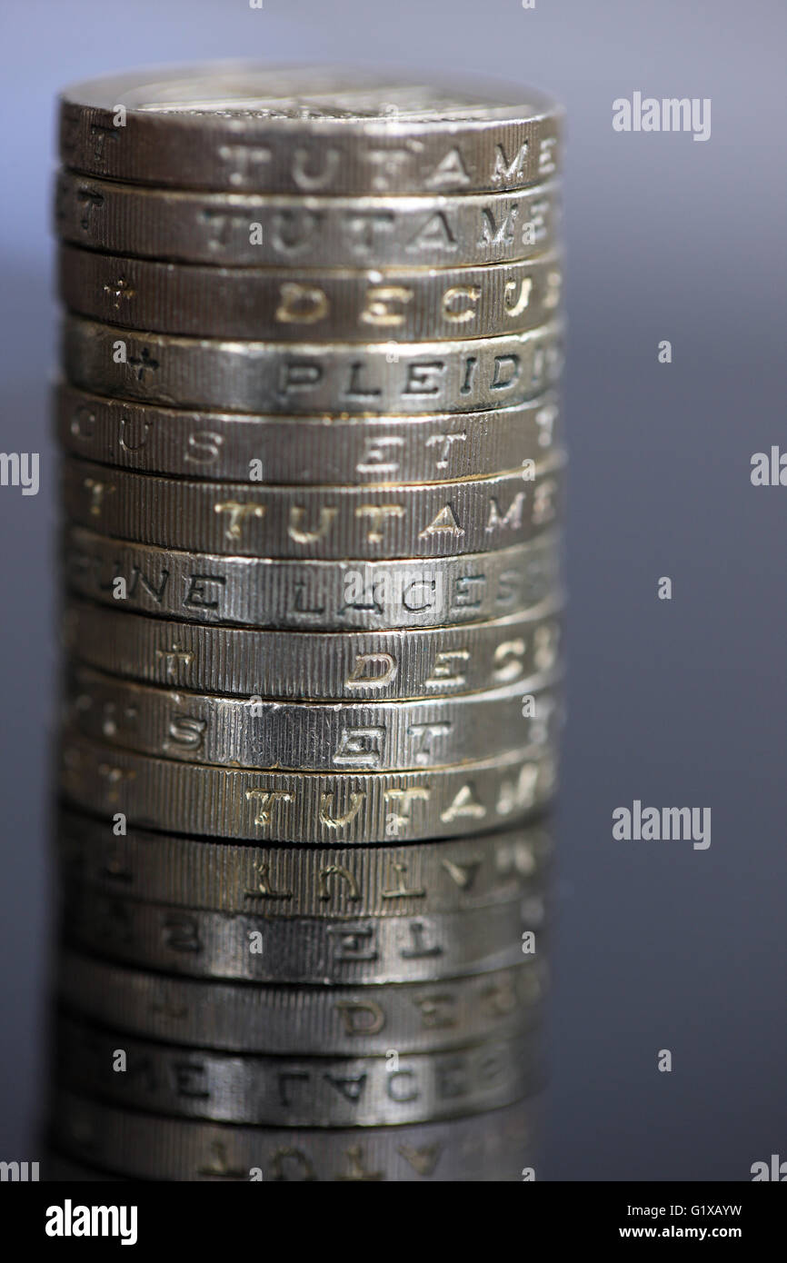 Ten, one pound coins in a stack and on a mirrored surface Stock Photo