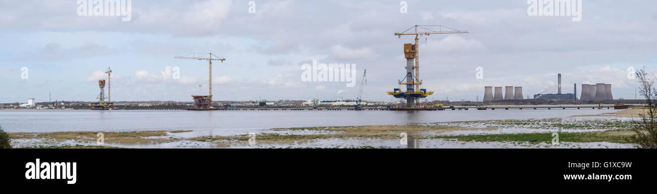 Mersey Gateway Bridge construction across the River Mersey upstream from the Queensway Bridge connecting Runcorn - Stock Image