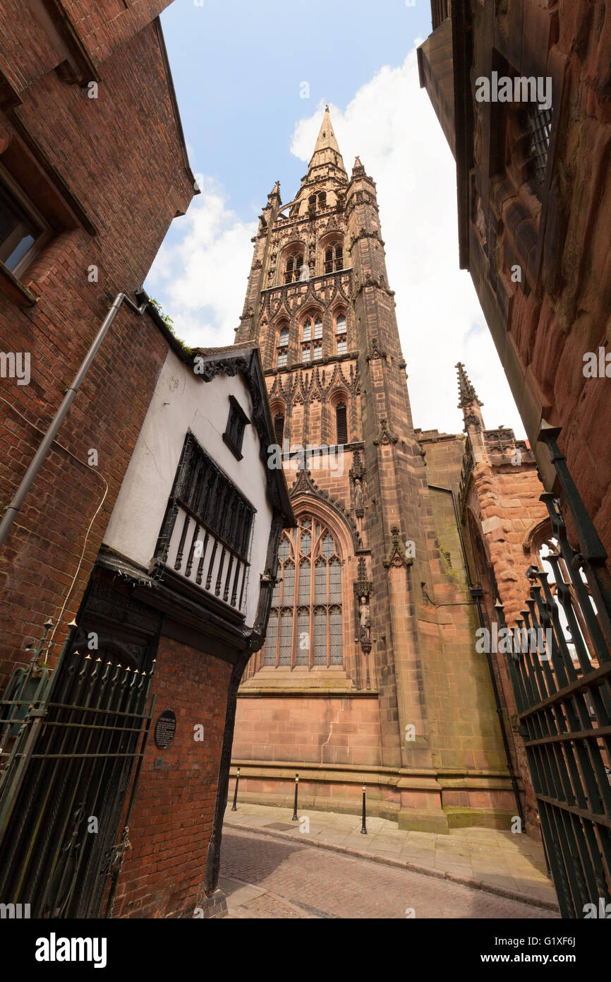 Old St Michaels Cathedral spire, and medieval houses, Coventry Warwickshire UK - Stock Image