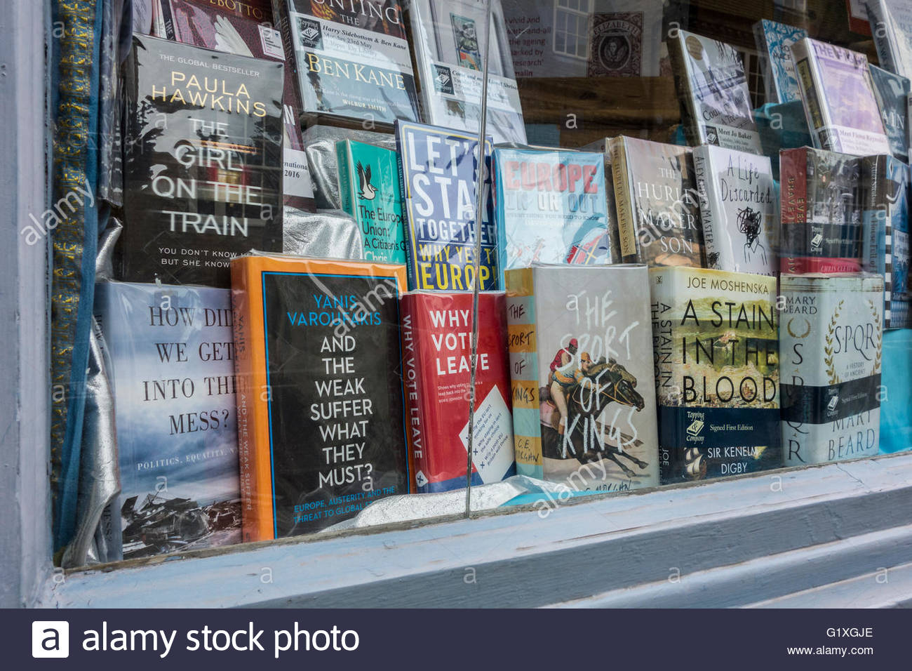 A range of topical books relating to the EU Referendum  in the window of a local bookseller in the High Street, - Stock Image