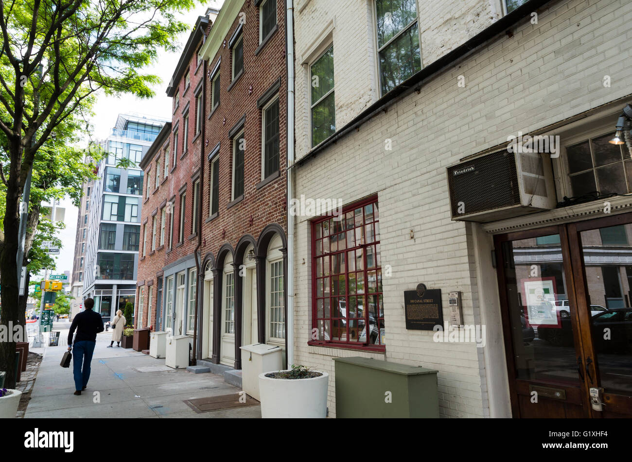 Street view of landmarked early 19th Century brick houses on Canal Street in New York City Stock Photo