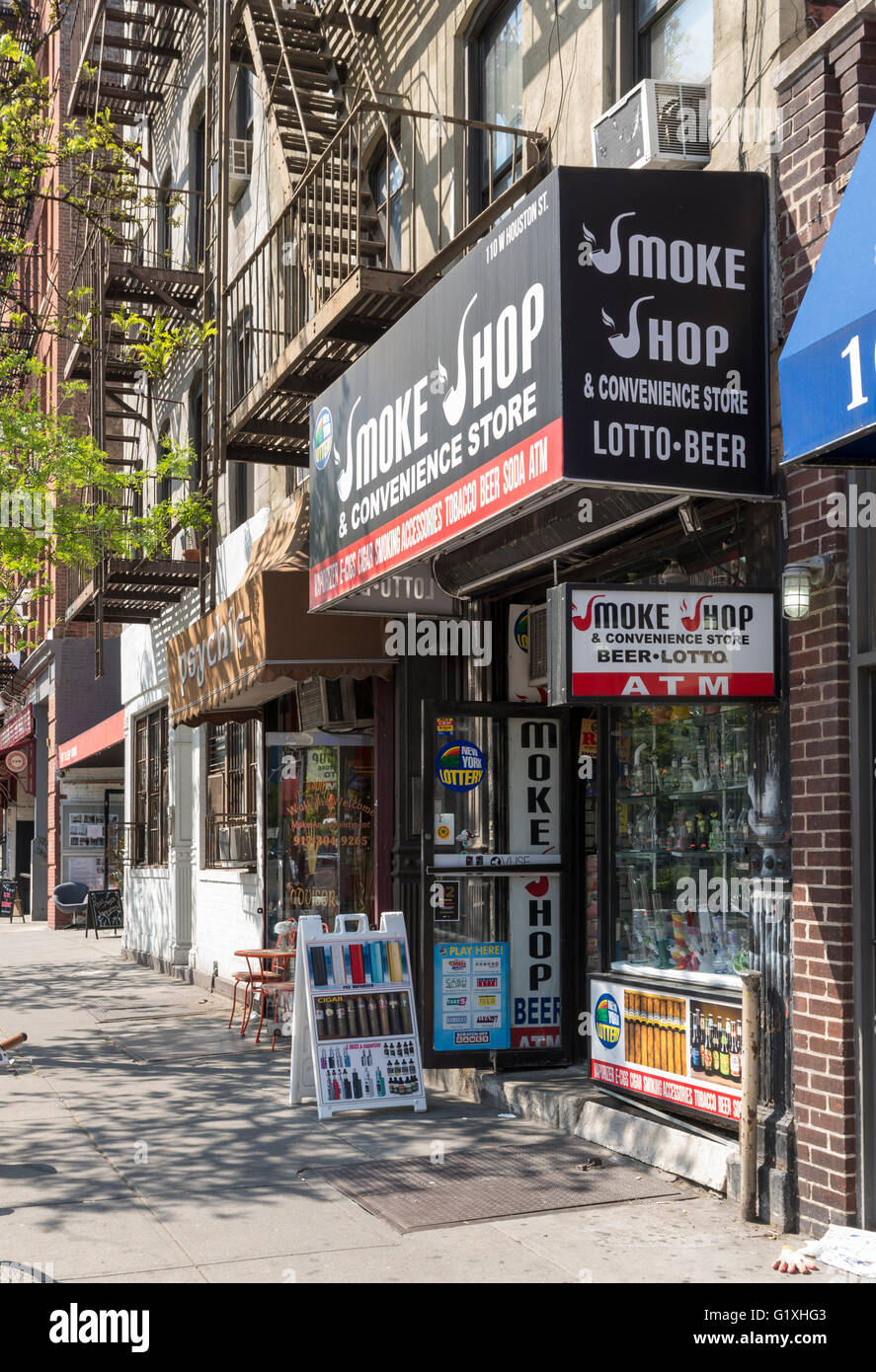 Exterior street view of a typical American / New York Smoke Shop selling tobacco products, e-cig supplies and bongs. - Stock Image