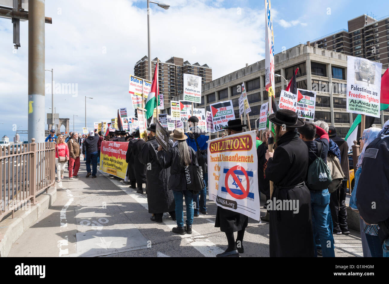Anti Zionism Orthodox Jews protesting against Israel and Pro-Palestine marching along Brooklyn Bridge, New York, - Stock Image
