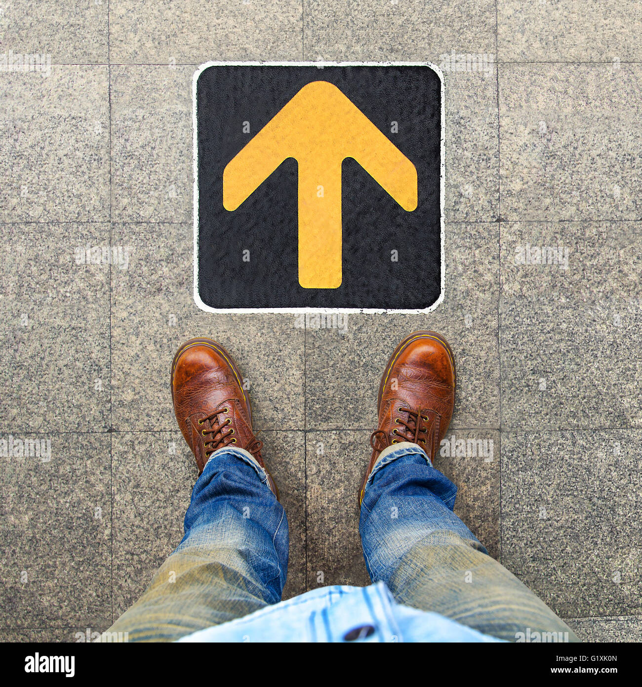 Yellow arrow to indicate the travel of the arrow - Stock Image