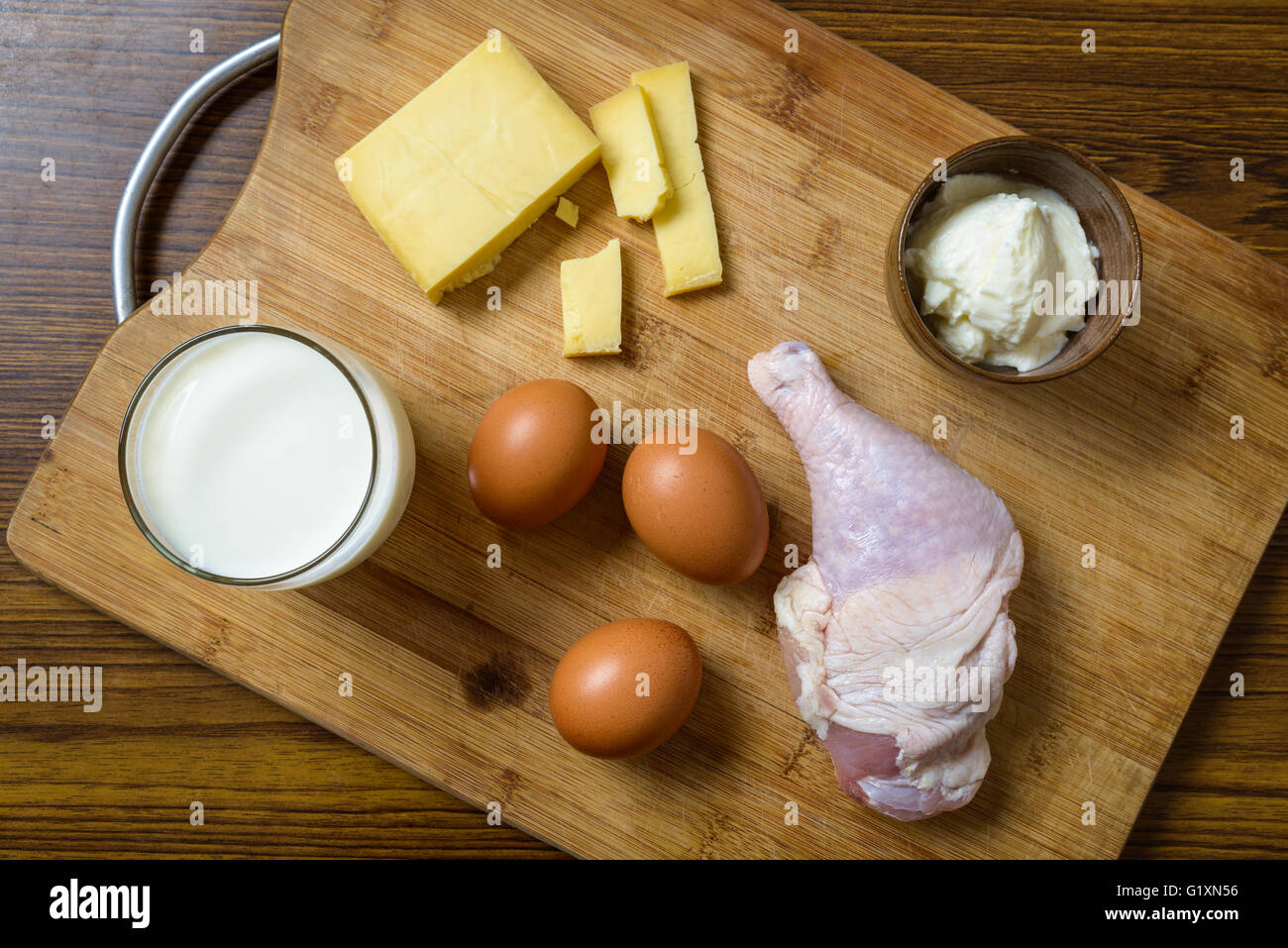Protein rich ingredients on a wooden board - Stock Image