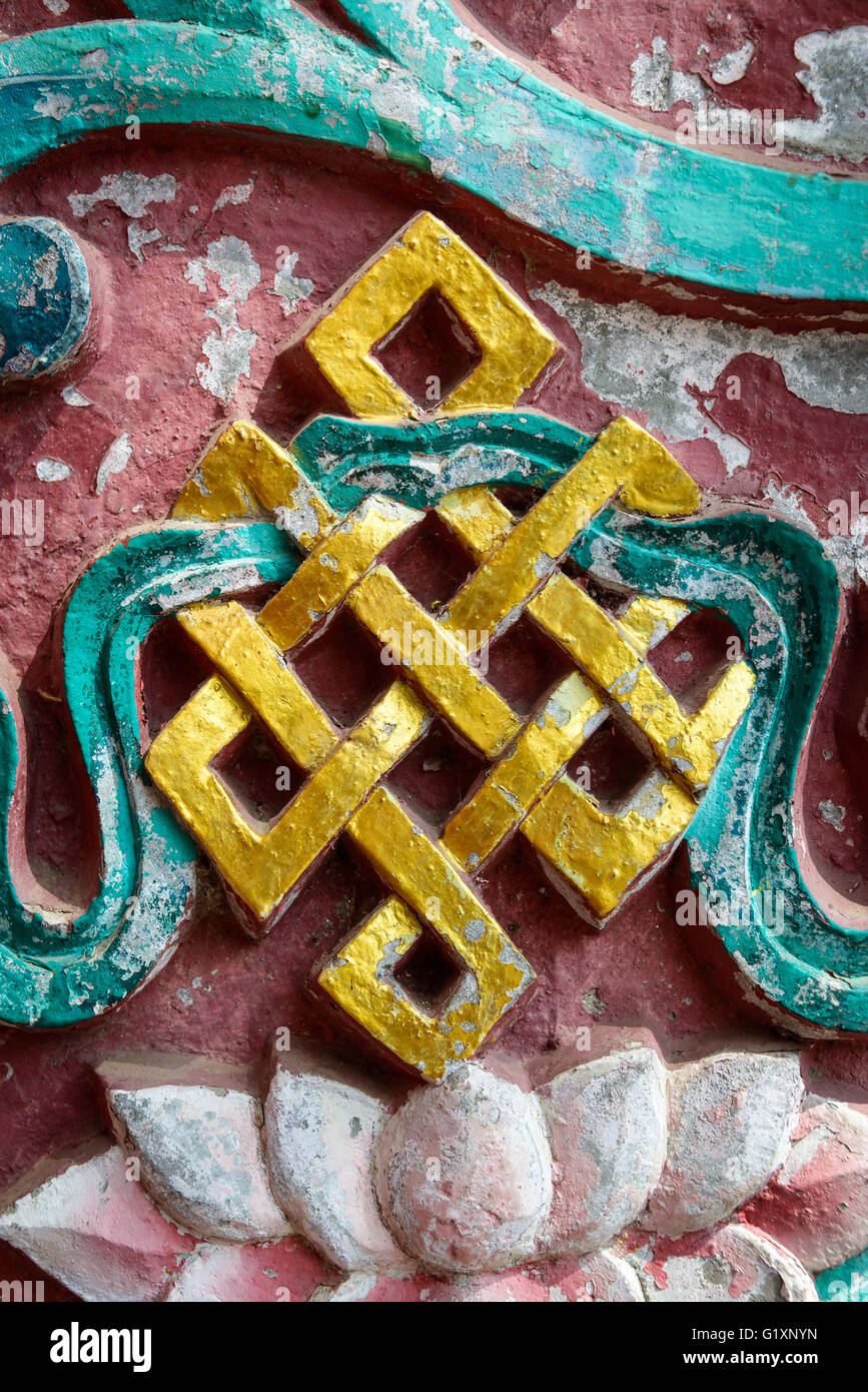 Golden endless knot in Nepal - Stock Image