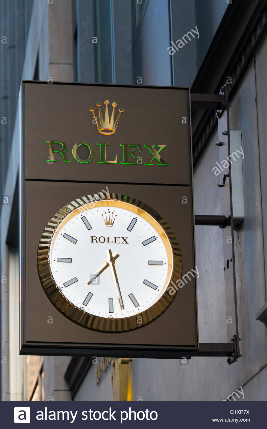 Rolex clock and sign is watches store entrance.   Rolex SA and its subsidiary Montres Tudor SA design, manufacture, - Stock Image