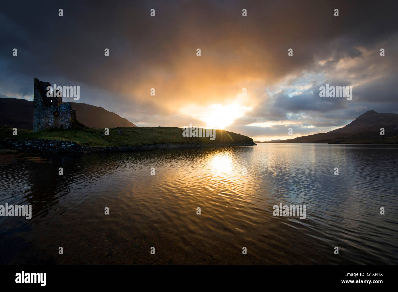 Dramatic sunset at Ardvreck Castle, on Loch Assynt in Sutherland Scotland UK - Stock Image