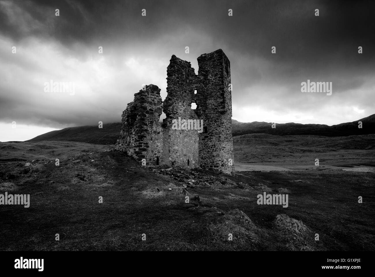 Monochrome moody morning light at Ardvreck Castle, on Loch Assynt in Suthlerland Scotland UK - Stock Image