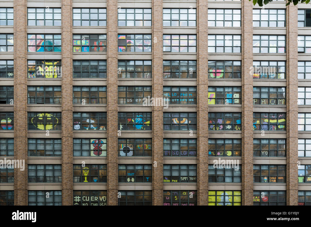 city building windows. Colourful Pixel Art Made From Post It Notes By Employees In The Windows Of  Rival Office Buildings On Canal Street New York City