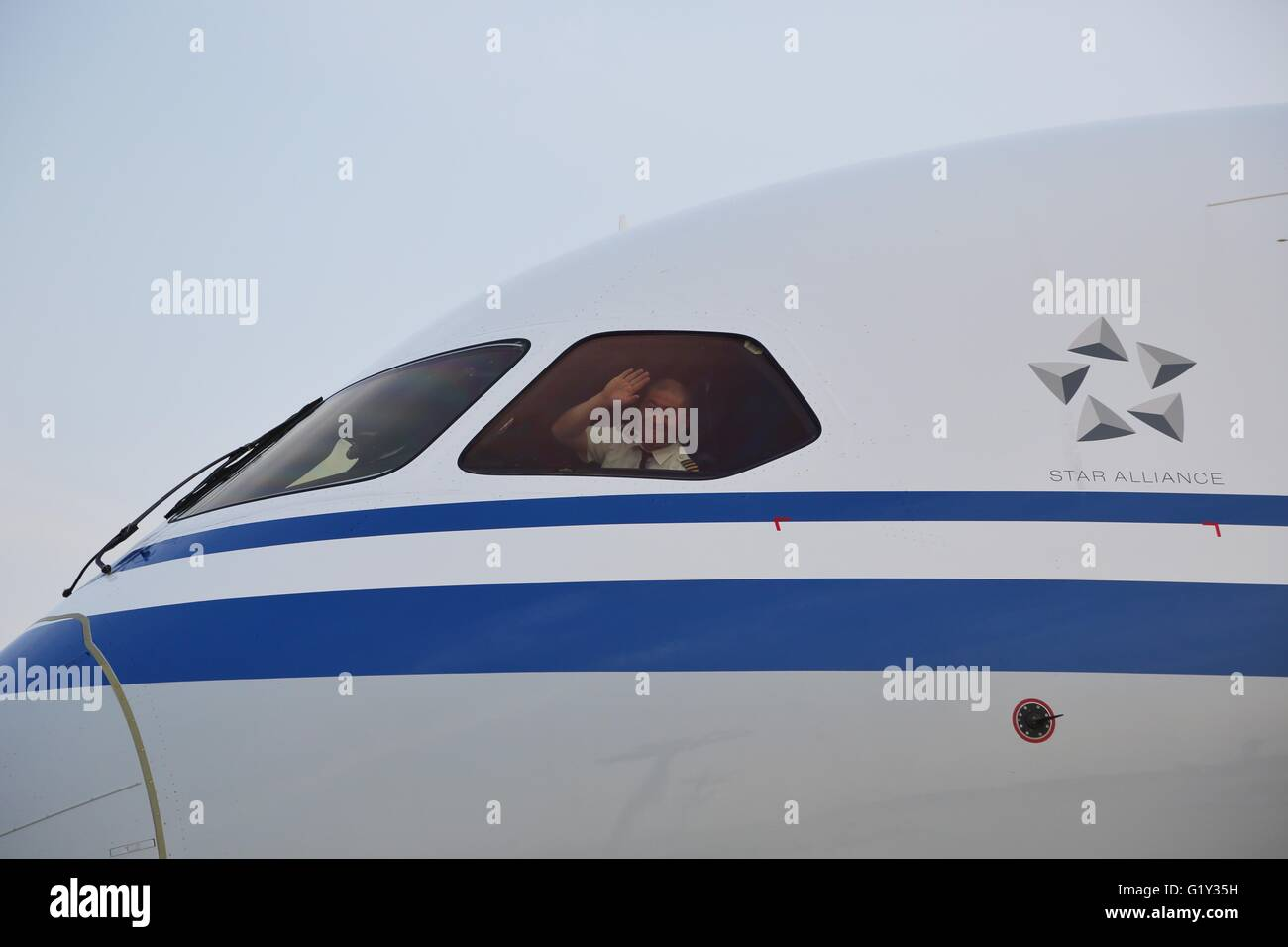 Chinese 787 dreamliner stock photos chinese 787 dreamliner stock beijing china 20th may 2016 a pilot waves hands from a boeing publicscrutiny Images