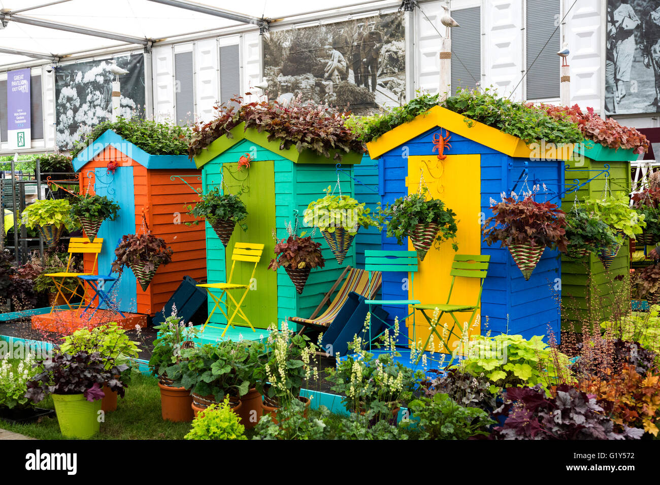 London, UK. 21 May 2016. Sheds turned into colourful beach huts ...