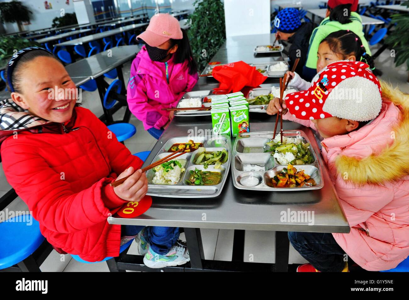 Lhasa, China's Tibet Autonomous Region. 22nd Jan, 2016. Children of Lhasa charity house have meals in canteen - Stock Image