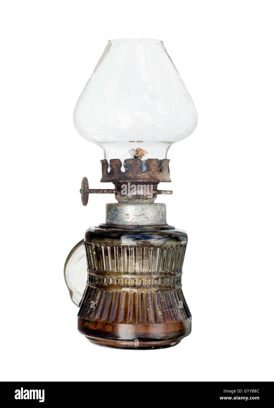 Old and used kerosene lamp on white background - Stock Image