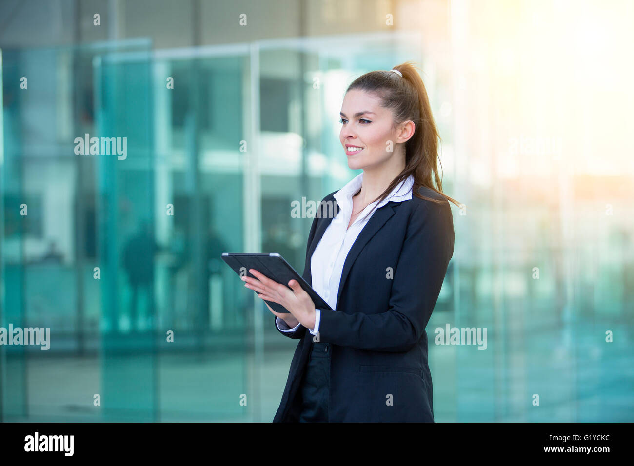 Businesswoman using a digital tablet - Stock Image