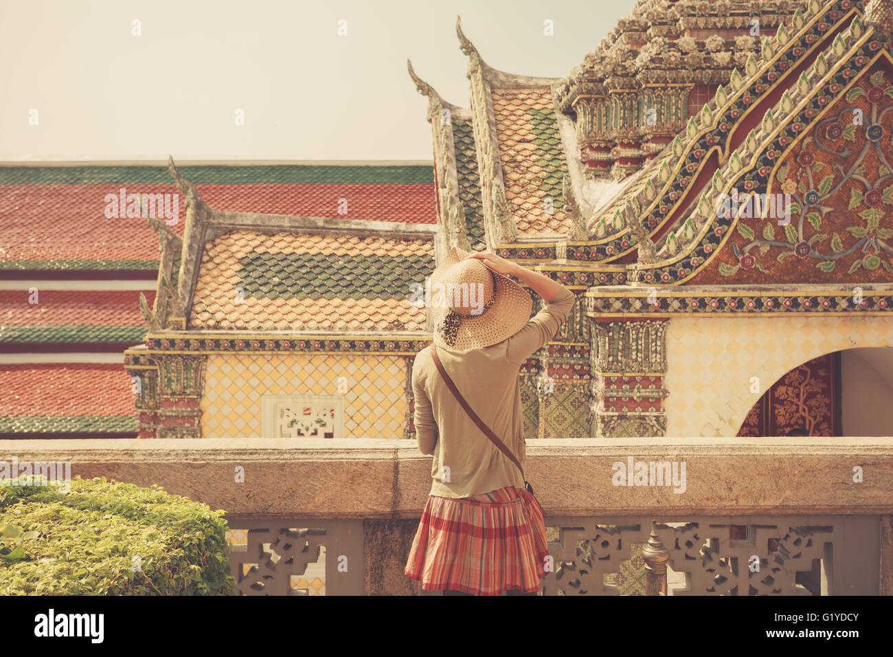 A young woman is exploring a palace in Thailand - Stock Image