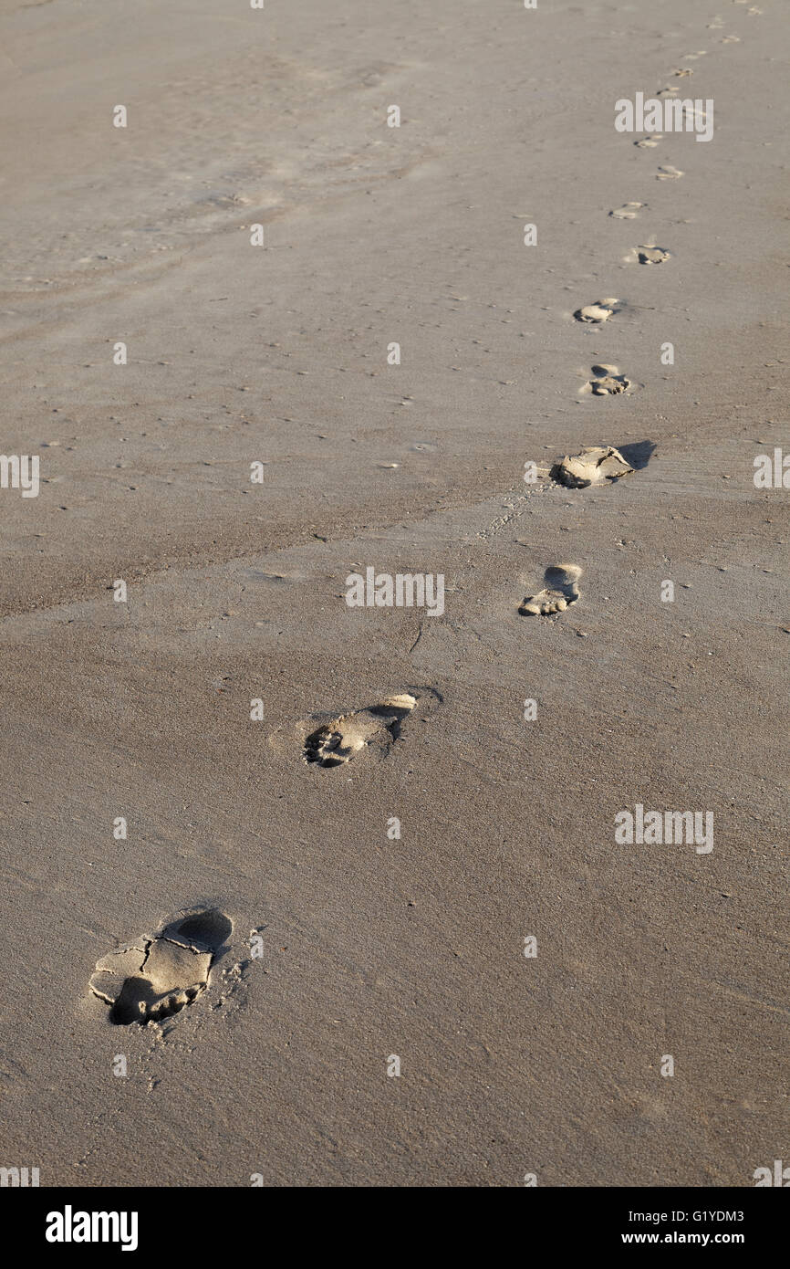 barefoot-footprints-on-the-beach-in-the-