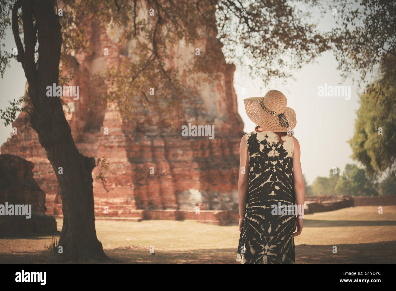 A young woman is exploring the ancient ruins of a buddhist temple city Stock Photo