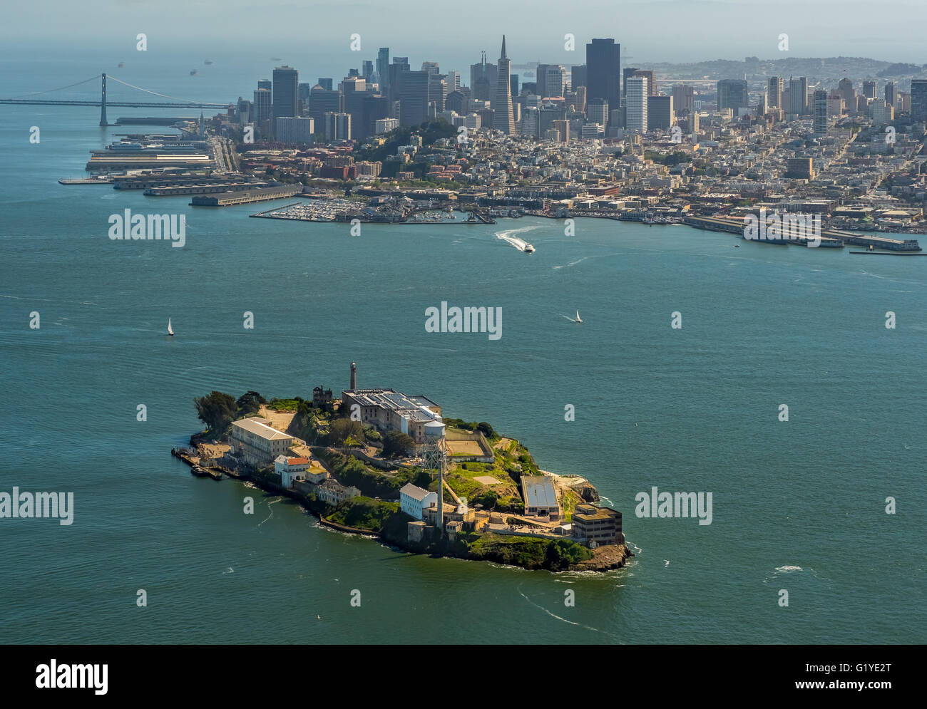 Aerial view, Alcatraz, Alcatraz prison island with lighthouse and San Francisco in the background, San Francisco - Stock Image