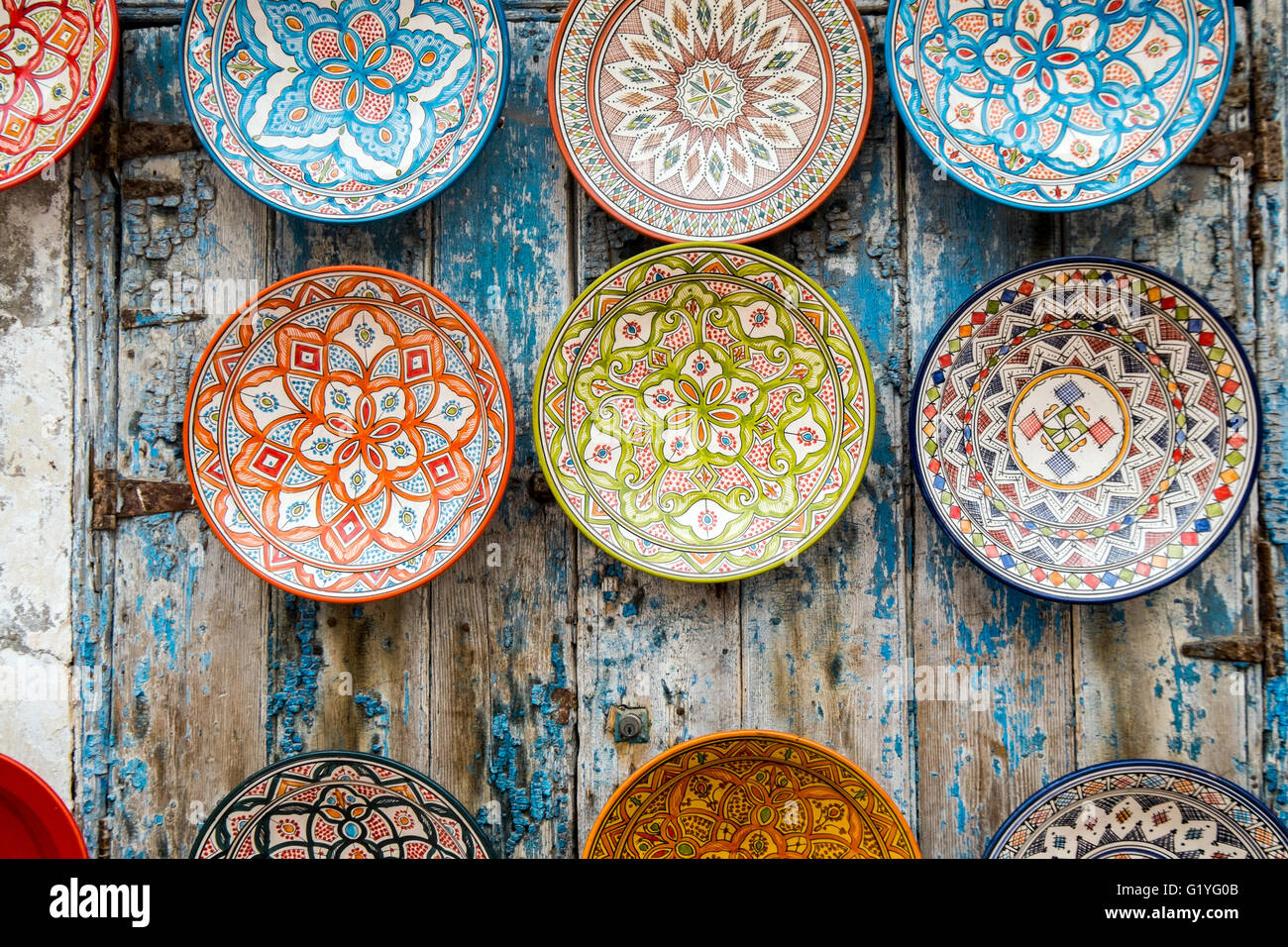 souvenir decorative plates on a wall in Essaouira Morocco & souvenir decorative plates on a wall in Essaouira Morocco Stock ...