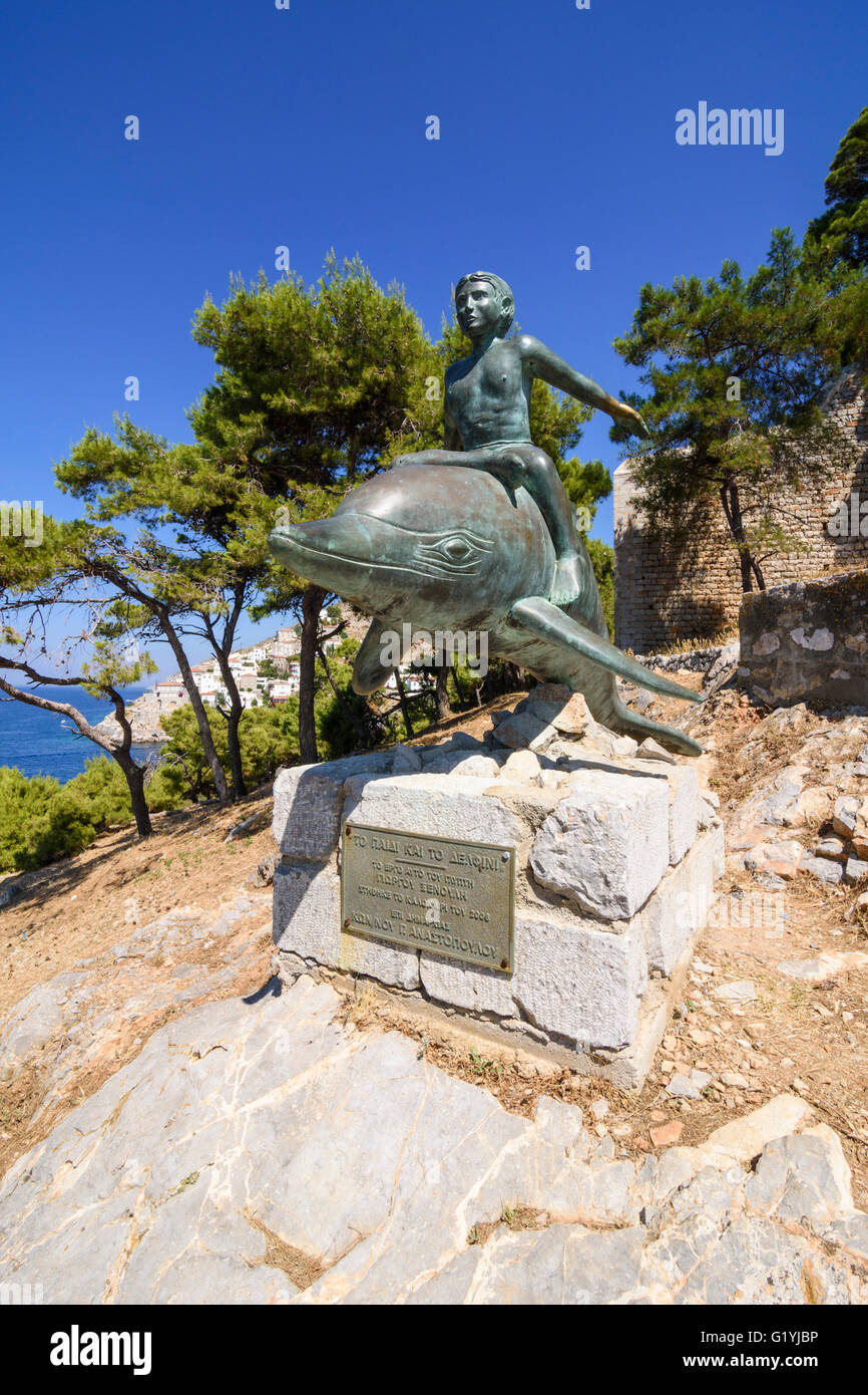 Boy on a Dolphin statue, a bronze artwork based on the film of the same name, filmed here in 1957, Hydra Island, - Stock Image