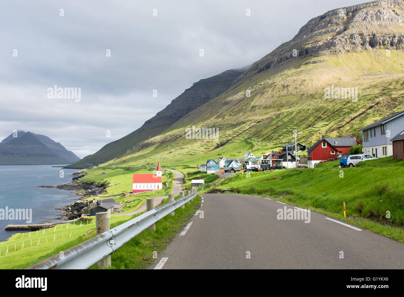The village Husar on the Faroe Islands as seen from the road - Stock Image