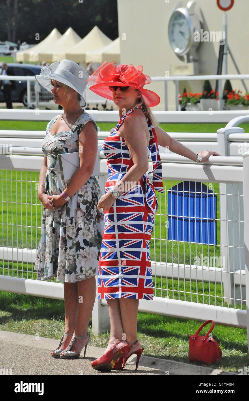 Two ladies dressed up for Ladies' Day at Royal Ascot race meeting. - Stock Image