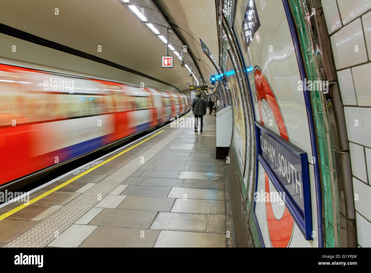 Inside view of London underground with motion train. - Stock Image