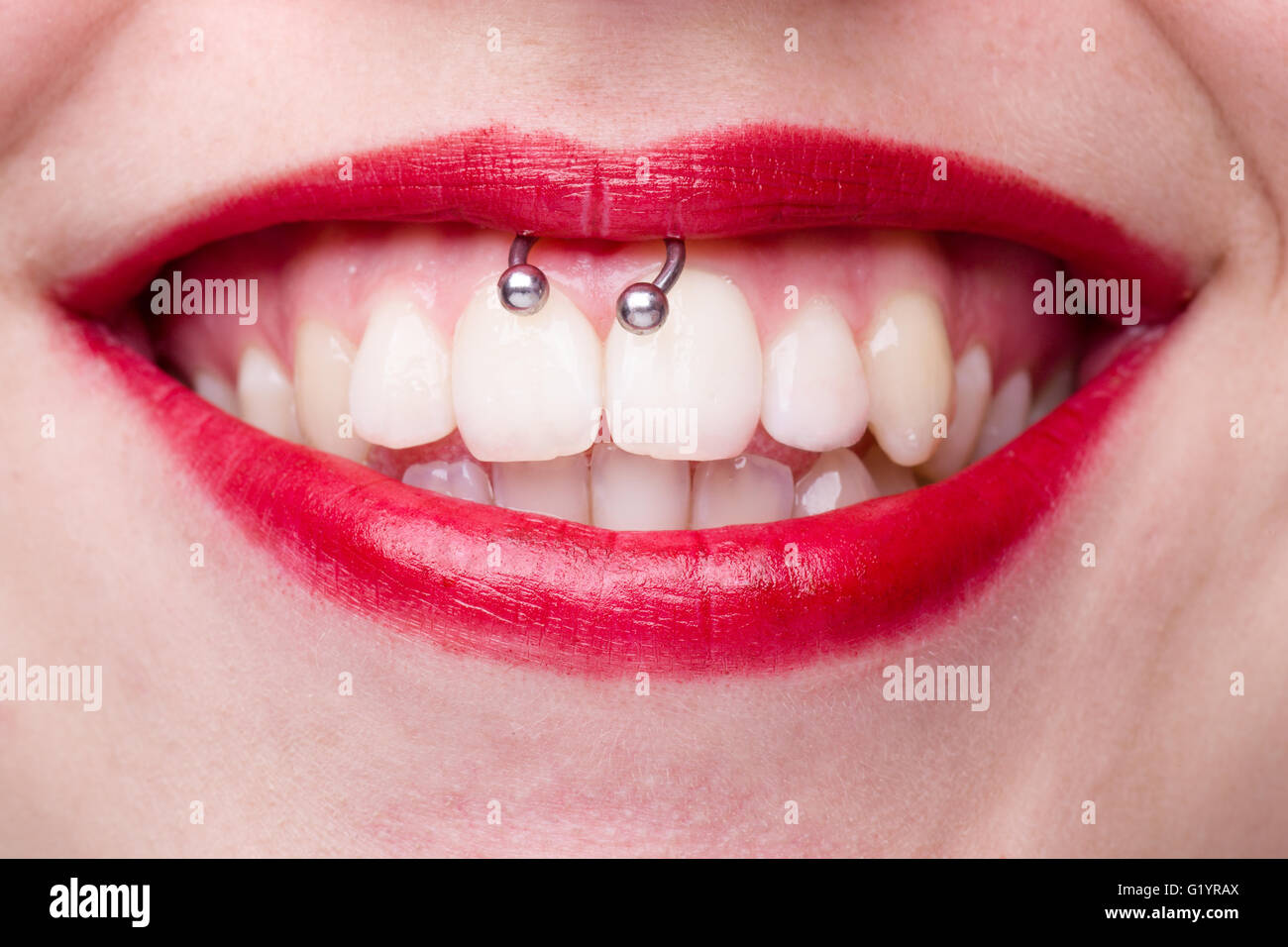 Smiley Piercing Detail With Smiling Woman S Mouth Stock Photo
