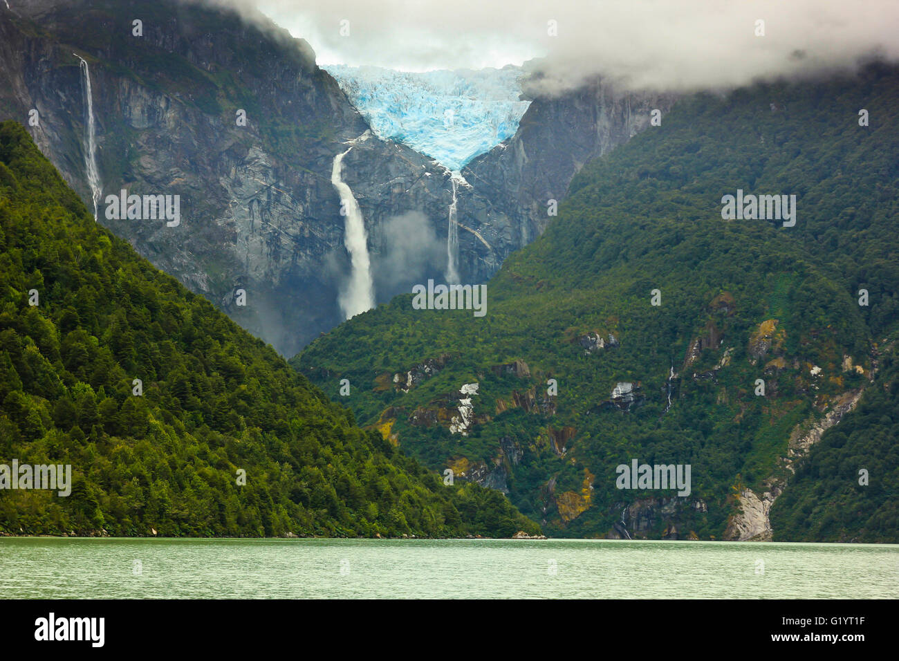 scenic view on glacier ventisquero calgante with waterfall and lake in chilean patagonia on the road Carretera austral - Stock Image