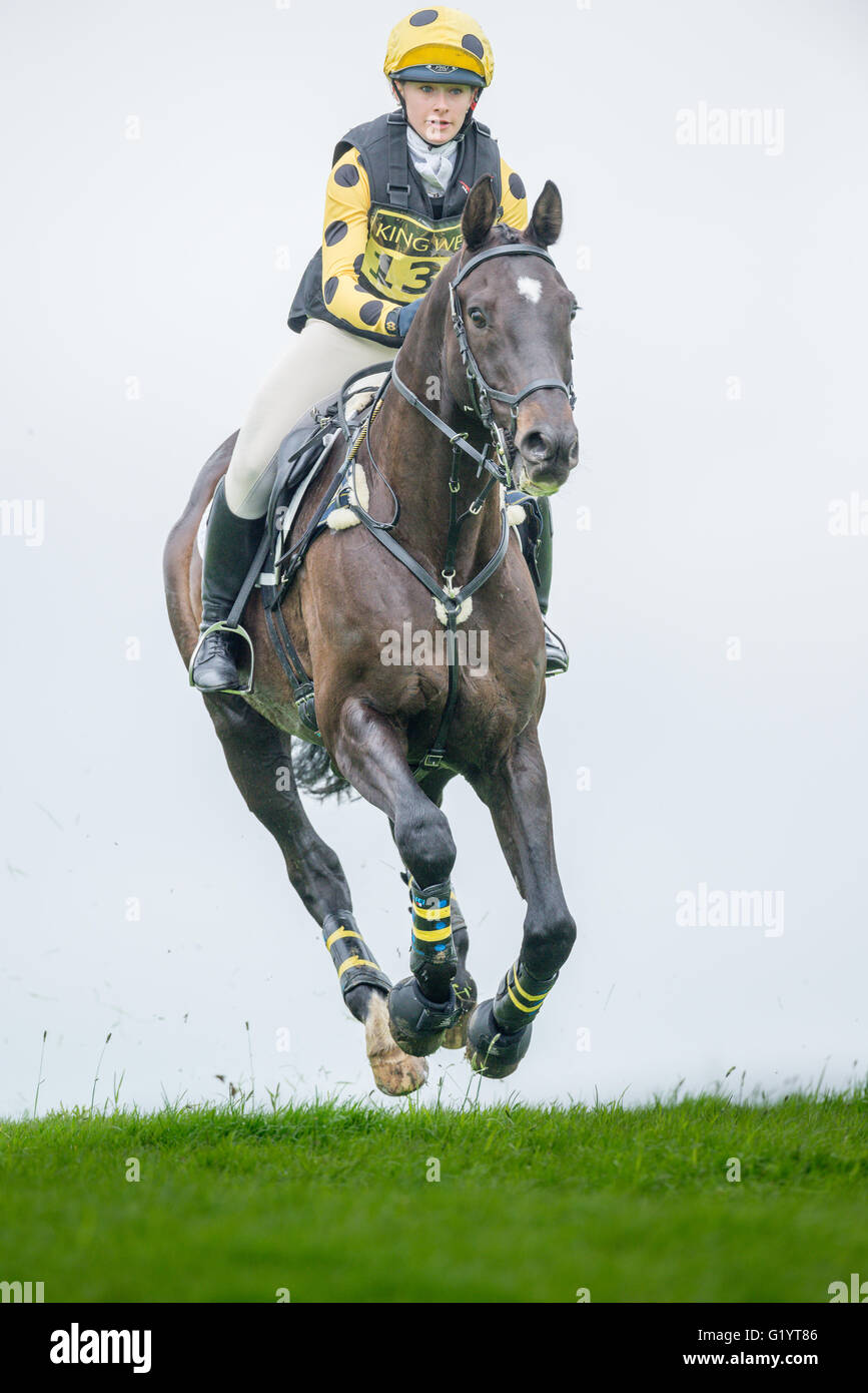 Yvie Jeanne on Oh Star II Z (owned by Holly Simmonds) races along an open stretch during the Rockingham cross country - Stock Image