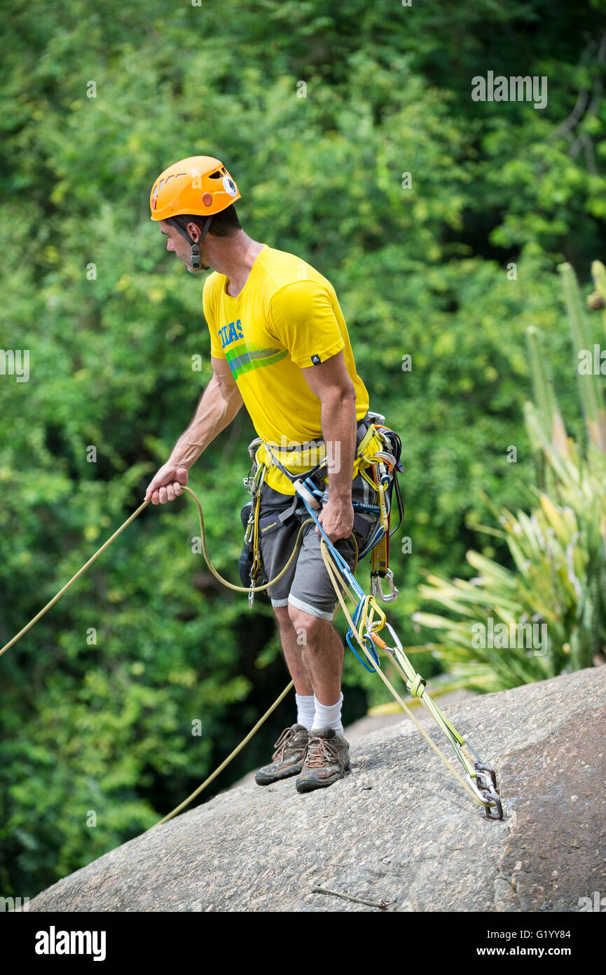 RIO DE JANEIRO - MARCH 5, 2016: A rock climber stands with safety ropes ready to descend the Morro da Urca at Sugarloaf Stock Photo